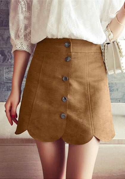 Girl in brown suede scallop hem miniskirt and white sheer top