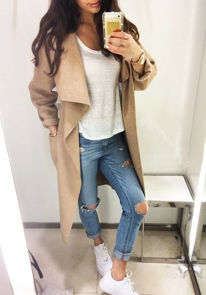 Girl in camel draped open-front long coat, white tee and dark denims
