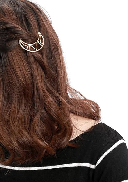 Girl in gold crescent-moon hair clip