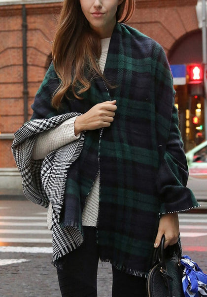 Girl's front wrapped in a green plaid reversible shawl