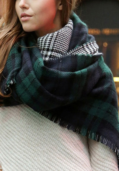 Girl's neck wrapped in a green plaid reversible shawl