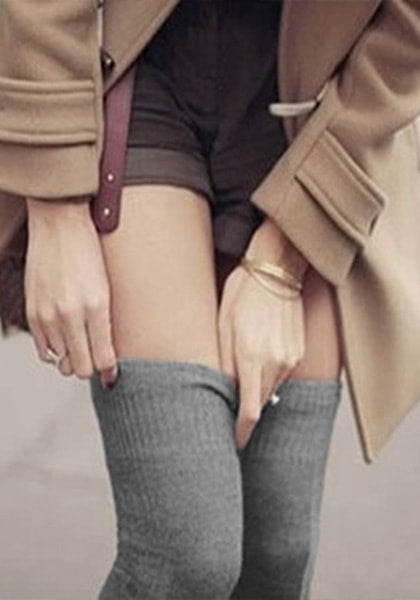 Girl wearing grey knee-length knit leg warmers