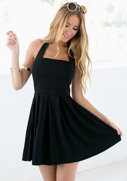 Girl wears black halter skater dress