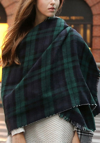 Girl wrapped in a green plaid reversible shawl