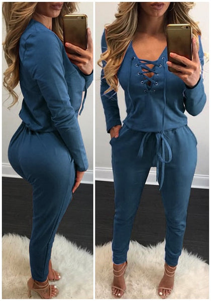 Images of model wearing blue grommet lace up long sleeves jumpsuit