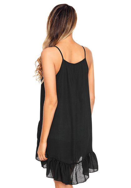 Back view of model wearing black asymmetrical ruffle hem faux wrap tank top