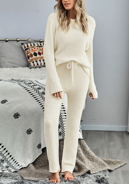 Model poses wearing beige fuzzy knitted fleece drawstring-waist loungewear set