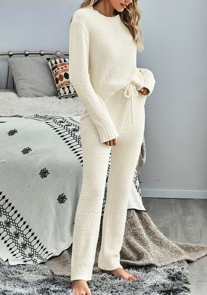 Side view of model wearing beige fuzzy knitted fleece drawstring-waist loungewear set