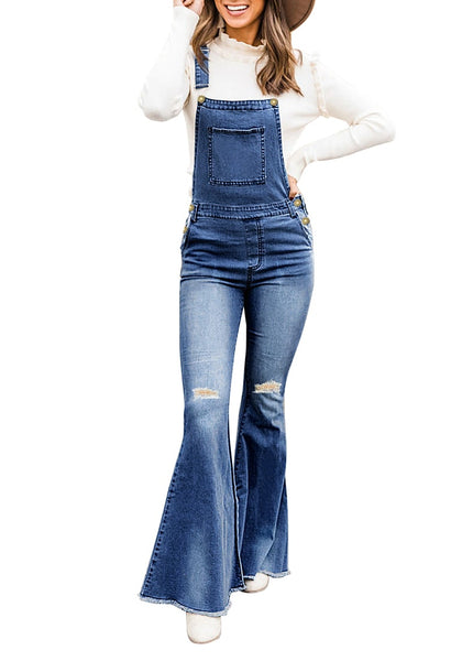 Front view of model wearing dark blue bell bottom ripped denim bib overall jumpsuit
