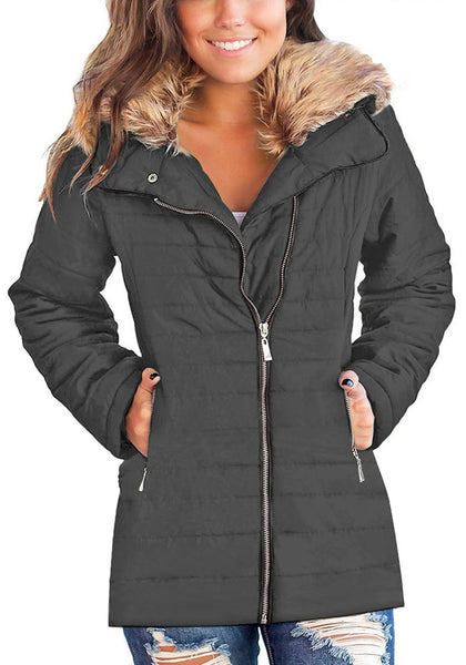 Front view of model wearing gray oversized faux fur collar zip up quilted jacket