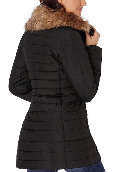 Back view of model wearing black oversized faux fur collar zip up quilted jacket