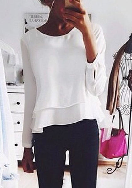 Lady is wearing white layered chiffon blouse