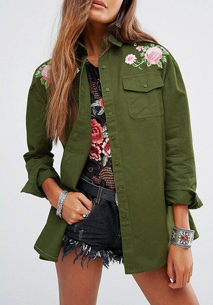 Lady wearing army green floral-embroidered shoulder shirt