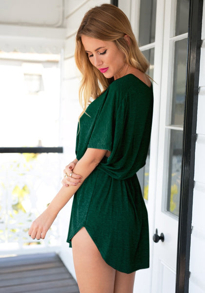 Lefr side view of model in green t-shirt dress