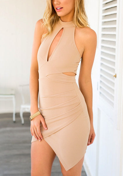 Left-angled shot of model in a f peach keyhole wrap-style dress