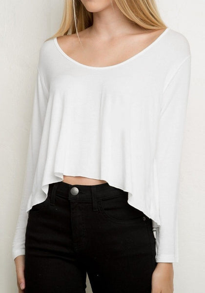 Left-angled shot of model in a white loose high-low tee