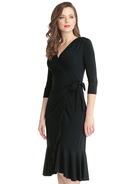 Left angle shot of woman in black asymmetrical ruffled wrap dress