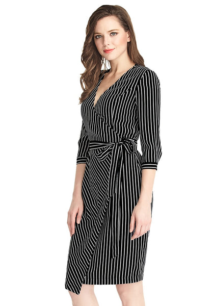 Left angle shot of woman in striped plunge asymmetrical belted wrap-style dress