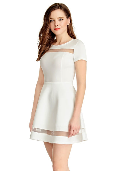 Left angled shot of model in White Mesh-Panel Short-Sleeve Skater Dress