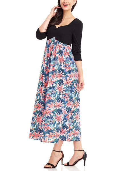 Left angled shot of model in black floral print-bottom sweetheart neckline long dress
