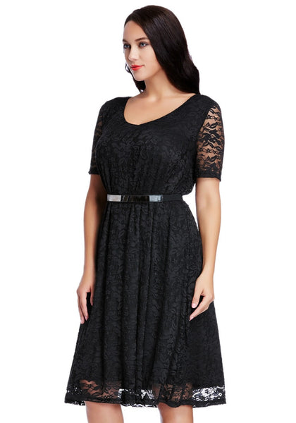 Left angled shot of model in plus size black lace midi dress