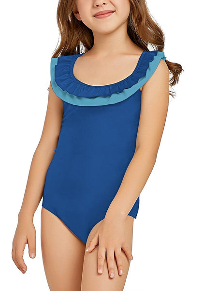 Left angled shot of model in royal blue layered ruffle neckline one-piece girl swimsuit