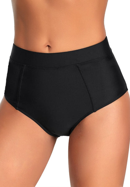 Left angled shot of model wearing black elastic mid-waist side pockets bikini bottom