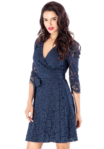 Left angled shot of model wearing navy floral lace overlay wrap dress