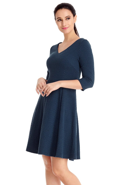 Left angled shot of model wearing navy geometric textured casual skater dress