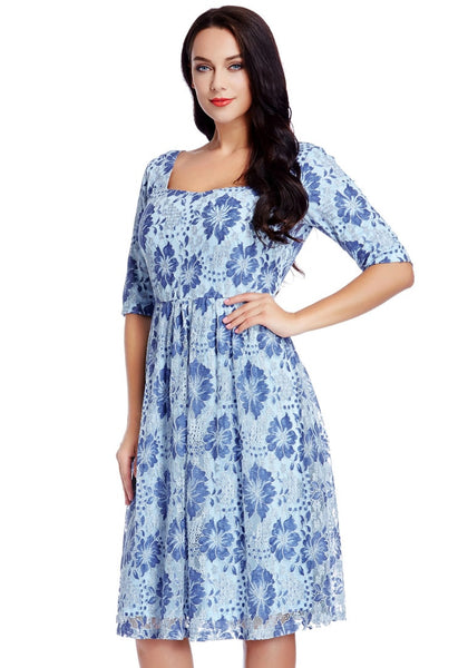 Left angled shot of model wearing plus size light blue floral-print lace dress