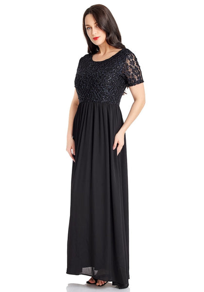 Left angled view of model in black floral hollow lace sequin-embellished maxi dress