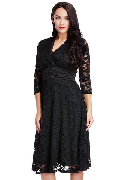 Left angled view of model in black lace surplice ruched-waist dress