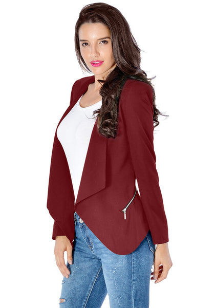 Left angled view of model in burgundy draped blazer