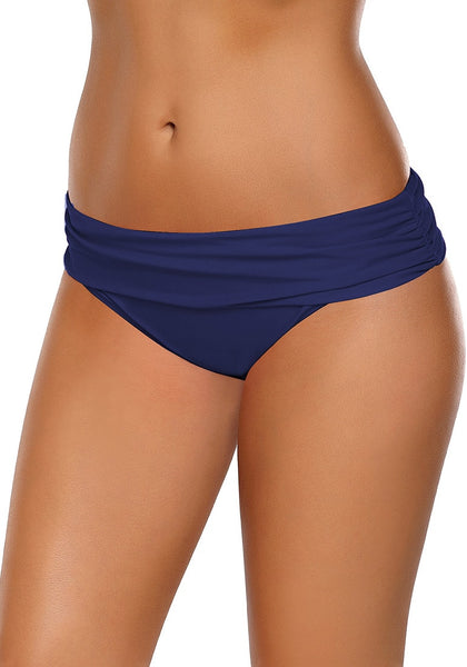 Left angled view of model in navy shirred waistband swim bottom