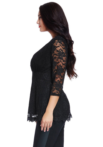 Left angled view of model in plus size black lace scallop blouse