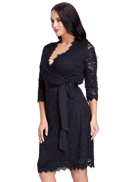 Left angled view of model in plus size navy lace crop sleeves wrap dress