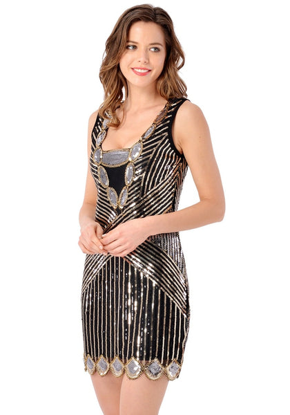 Left angled view of model wearing black scallop hem sequined flapper dress