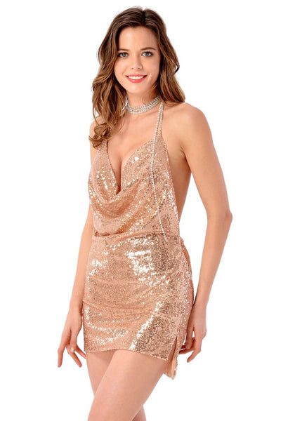 Left angled view of moderl wearing champagne cowl-neck open-back sequin dress