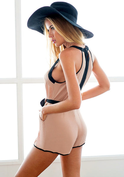 Left back view of  model in slit back romper