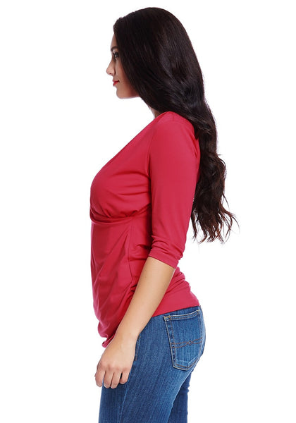 Left side shot of model in plus size red ruched surpliced top