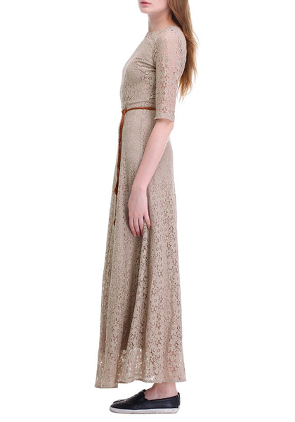 Left side shot of woman in a khaki maxi lace dress