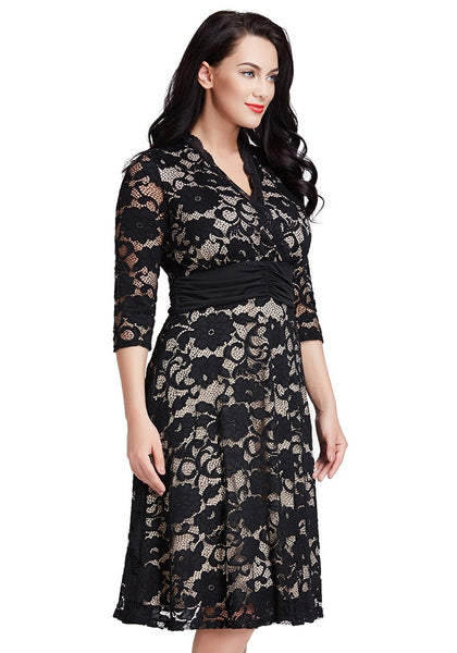 Left side shot of woman in plus size apricot lace surpliced ruched-waist dress