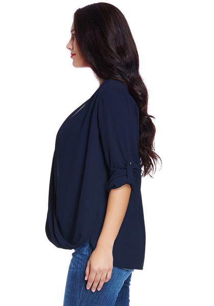 Left side shot of woman in plus size navy blue Mandarin collar surplice shirt