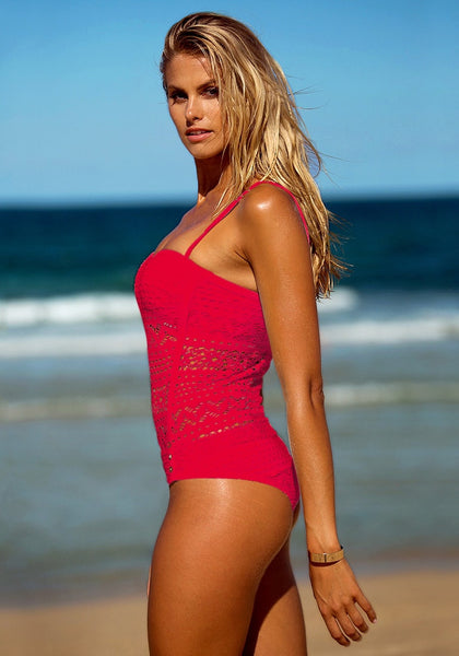 Left side view of blonde girl in a red lace halter swimsuit