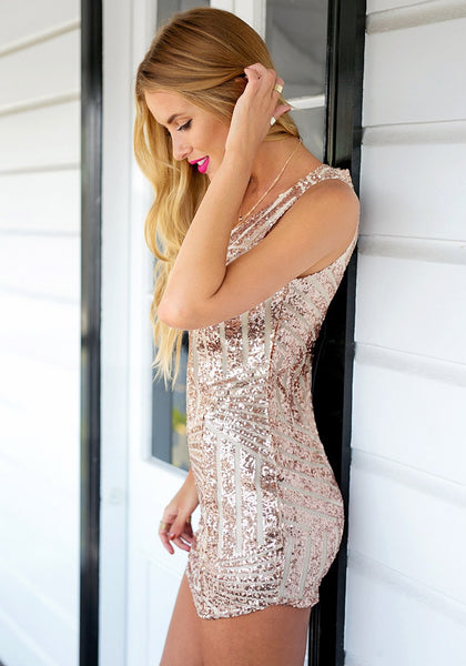Left side view of girl in champagne sequin party dress