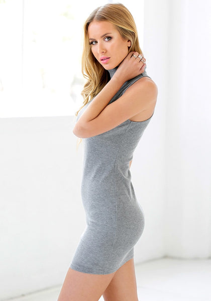 Left side view of girl in grey sleeveless turtleneck dress