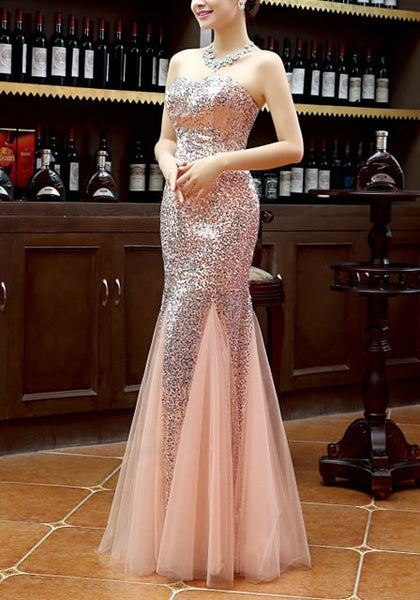 Left side view of girl in peach sequin mermaid evening gown