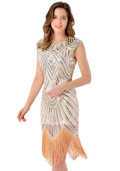 Left side view of model in apricot sequin fringed flapper dress