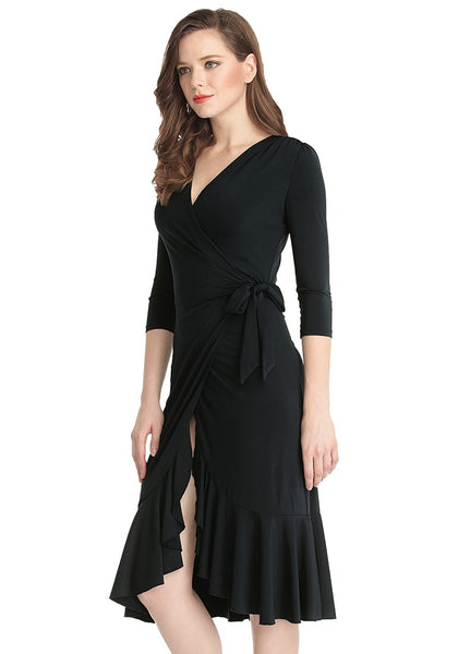 Left side view of model in black asymmetrical ruffled wrap dress