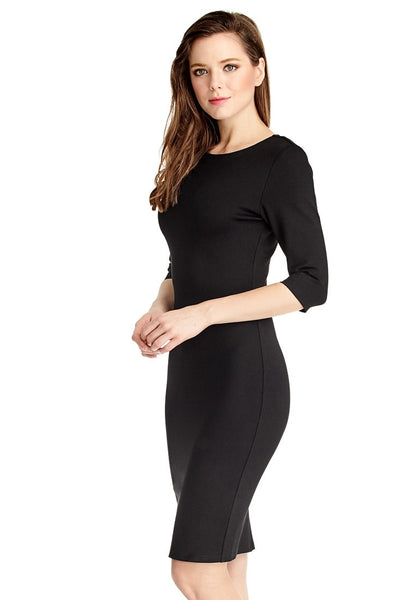 Left side view of model in black classic bodycon midi dress